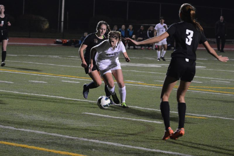 by: TIMES PHOTO: MATT SINGLEDECKER - Jesuit senior forward Dani Brown dives into the middle of the Beaverton defense before getting off a goal during the Crusaders 1-0 win on Thursday.
