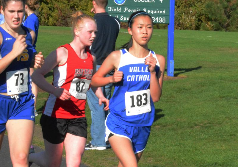 by: TIMES PHOTO: MATT SINGLEDECKER - Valley Catholic sophomore Ermina Lee was part of a Valiant pack that helped Valley take first as a team at the Special District One Championships.