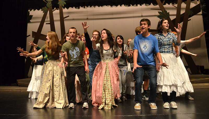 by: TIDINGS PHOTO: VERN UYETAKE - The cast of West Linn High Schools production of Into the Woods rehearses Oct. 28.