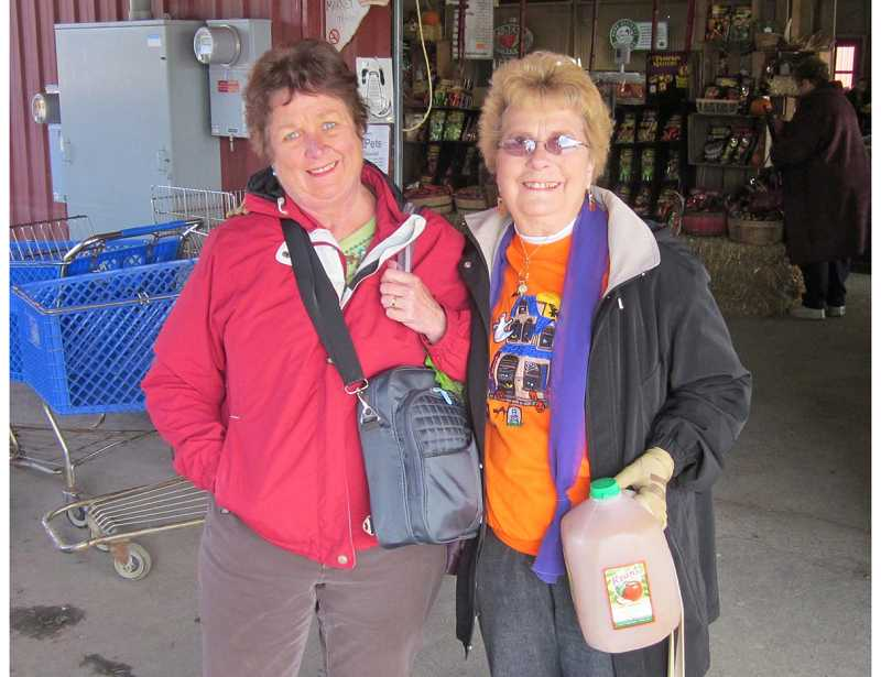by: BARBARA SHERMAN - FUN ON THE FARM - Summerfield residents Kathy Peterson (left) and Mary Morgan hitched a ride on the Estates bus so they could enjoy the Pumpkin Patch at Sauvie Island and purchase some goodies at the farm store.