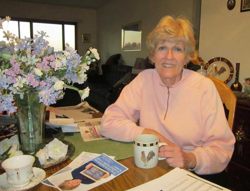by: BARBARA SHERMAN - GRATEFUL TO BE ALIVE - Jeanette Hall, in her King City home with one of her posters on the table, prepares to leave for Quebec, Canada, to speak out against a proposed assisted-suicide law