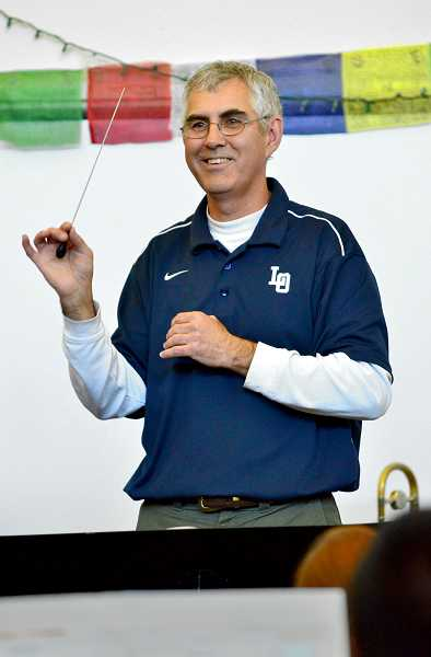 by: REVIEW PHOTO: VERN UYETAKE - Dave Matthys has served as the Lake Oswego High School band director for 11 years and is retiring.
