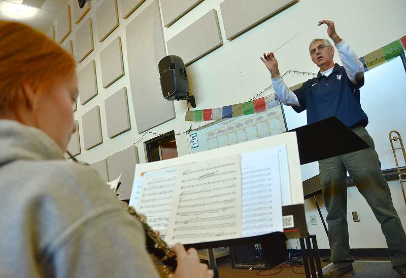 by: REVIEW PHOTO: VERN UYETAKE - Lake Oswego High School band director Dave Matthys said he loves teaching students to play together as a group.