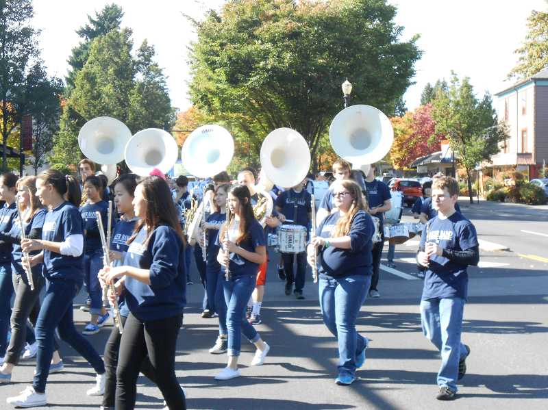 by: REVIEW PHOTO: JILLIAN DALEY - The LOHS marching band is an integral part of the annual homecoming parade.