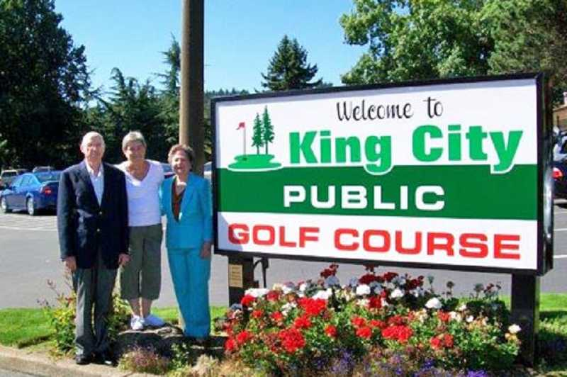 by: COURTESY OF THE KING CITY CIVIC ASSOCIATION - SIGN OF THE TIMES - Ed Klasek, president of the King City Civic Association Memorial Foundation, and Memorial Foundation members Pat Quartaro (center) and Billie Reynolds stand by the new sign that welcomes everyone to King City's public golf course.