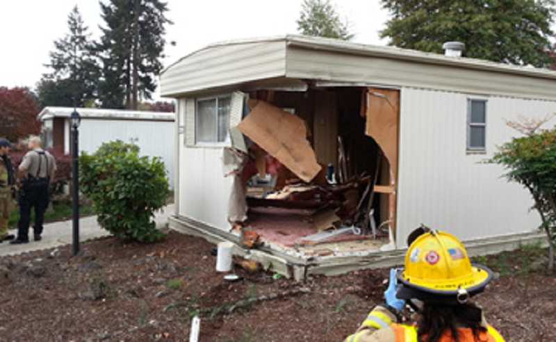 by: COURTESY OF TUALATIN VALLEY FIRE & RESCUE - NOT THE GARAGE DOOR - After smashing through one home in Eldorado Villas, Jack O'Rourke''s vehicle continued into a second hime, barely missing the resident.