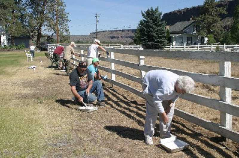 by: SUBMITTED PHOTO - Crooked River Ranch Seniors painted the big front fence at the Senior Center in June.