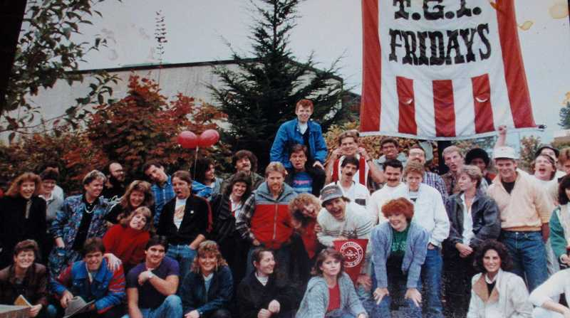 by: SUBMITTED - Employees at the T.G.I. Fridays Tigard location pose for a photo in the mid 1980s. More than 30 years later, the restaurant has closed its doors, but the employees are still as close as ever and returned to the restaurant on Saturday for a reunion.
