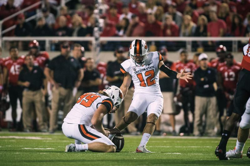 by: COURTESY OF OREGON STATE UNIVERSITY - Trevor Romaine is 9 of 12 on field goals this season for Oregon State, despite having to work with three long snappers, including the current job-holder, redshirt freshman Andrew Maughan from Oregon City.