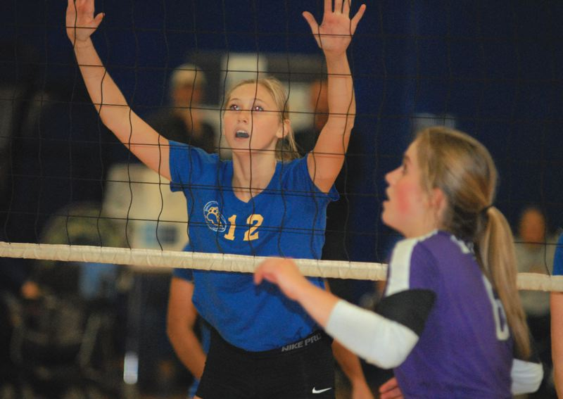 by: THE OUTLOOK: DAVID BALL - Barlows Brynna Stauffer watches action on the other side of the net in front of South Eugene setter Caroline Soule. The Bruins won the playoff match in three sets.