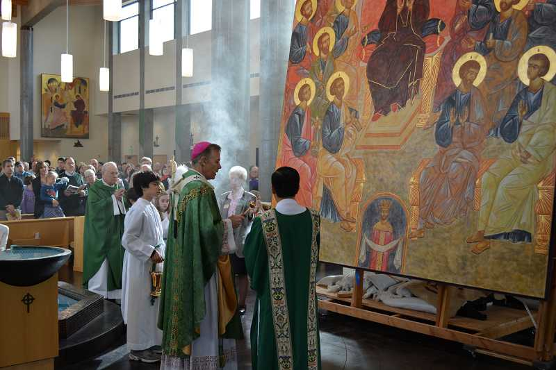 by: SUBMITTED PHOTO - Archbishop Alexander Sample, center, leads the blessing ceremony of Resurrection Catholic Parishs new icon on Sunday.