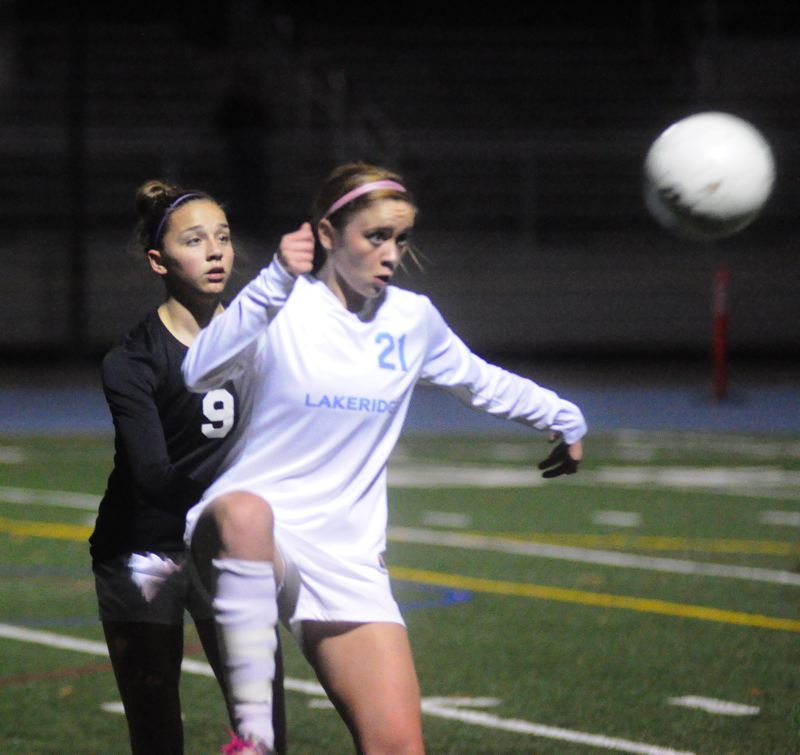 by: MATTHEW SHERMAN - Lakeridge's Shannon Walton looks to bring down a ball during Tuesday's 3-0 play-in victory over Forest Grove. The Pacers will now face Tigard in the first round of the playoffs.
