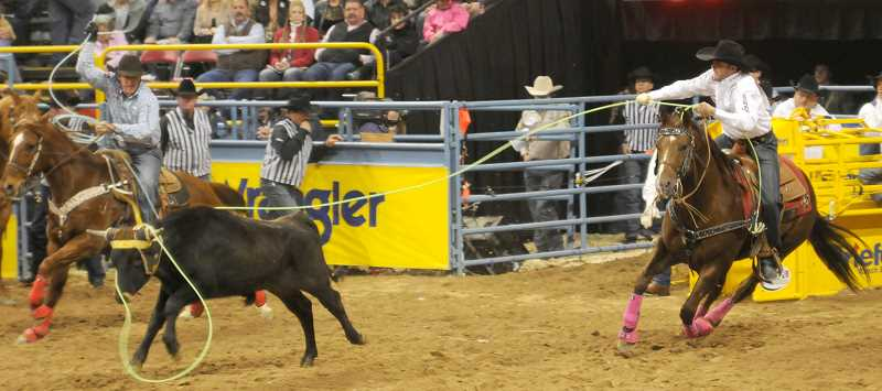 by: CENTRAL OREGONIAN FILE PHOTO - Team ropers, Brandon Beers, right, and Jim Ross Cooper, compete at the 2011 National Finals Rodeo. The duo are roping together again after Beers took much of the 2012 season off, and are the favorites to win this years Columbia River Circuit Finals. The Circuit Finals start tonight and run through Saturday inthe Hooker Creek Events Center at the Deschutes County Fairgrounds.