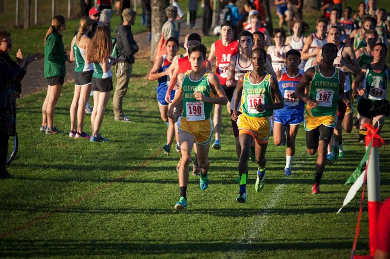 by: TRIBUNE PHOTO: ADAM WICKHAM - The PIL 5A boys cross-country district meet is off and running, with Cleveland's Alex Nova (190) and Nabi Amin (164) taking the lead. Amin finished first, and the Warriors were first as a team.