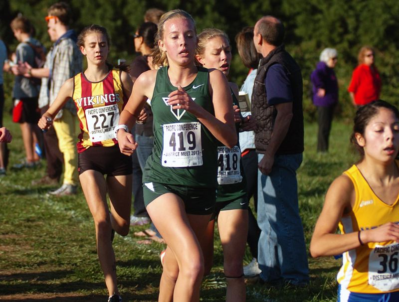 by: DAN BROOD - TIGER TEAMWORK -- Tigard freshman Marley Johnson (419) and junior Bailey Hardinge run together during last week's Pacific Conference district cross country championships.