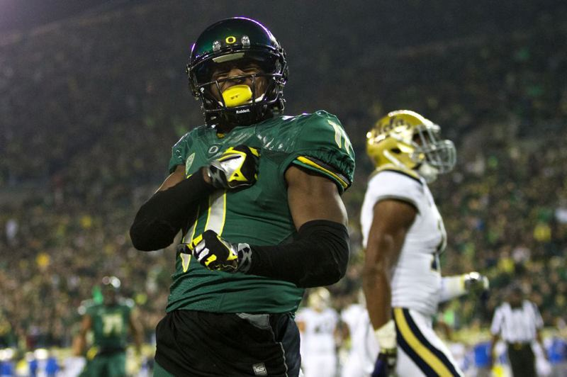 Bralon Addison strikes a pose after scoring at Autzen Stadium.
