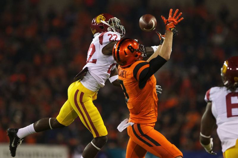 Trojans safety Leon McQuay III prevents Oregon State wide receiver Richard Mullaney from catching the ball in the second half.