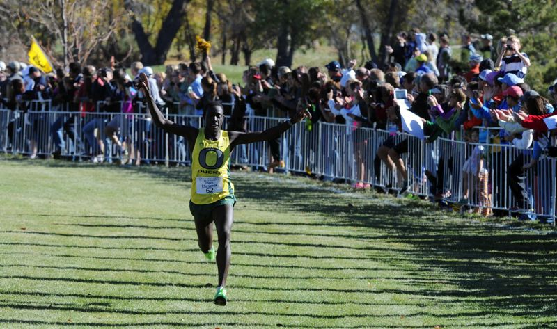 by: COURTESY OF PAC-12 CONFERENCE - Oregon's Edward Cheserek becomes the first Ducks freshman to win the Pac-12 men's cross-country championship, as he nears the finish Saturday at Louisville, Colo.