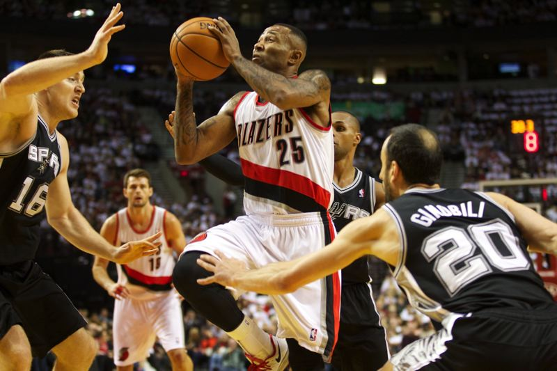Backup guard Mo Williams of Portland drives to the basket through the San Antonio defense.