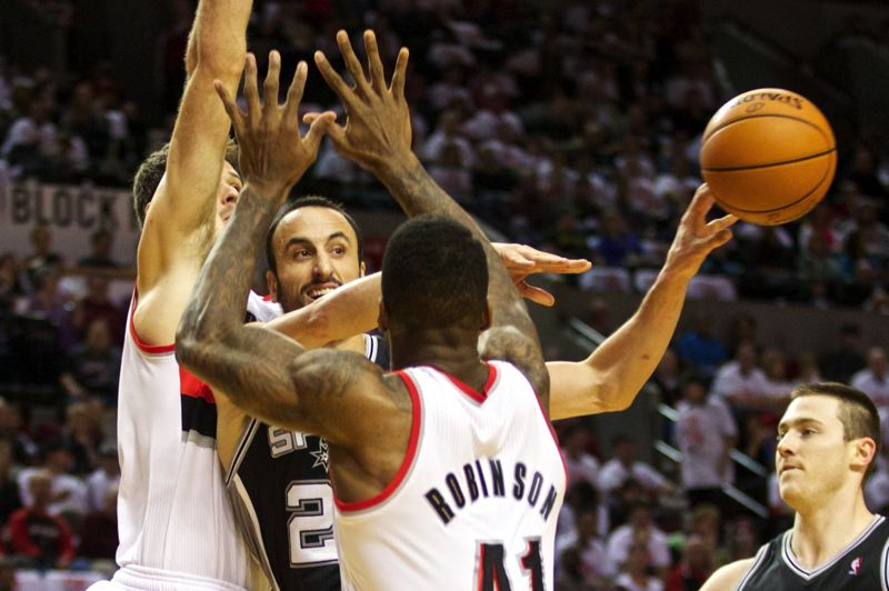 Blazers Joel Freeland (left) and Thomas Robinson double-team San Antonio's Manu Ginobili, forcing him to throw the ball out of bounds.