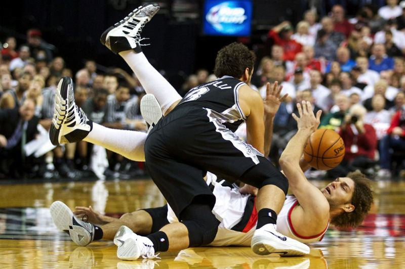 Blazers center Robin Lopez looks for a teammate to pass to after going for a loose ball against San Antonio guard Marco Belinelli