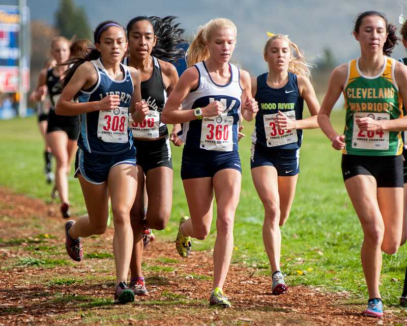 by: GREG ARTMAN - Taryn Rawlings (360) placed seventh at the Class 5A cross-country championships Nov. 2 at Lane Community College in Eugene. The senior earned four top-10 state finishes in her high school career.