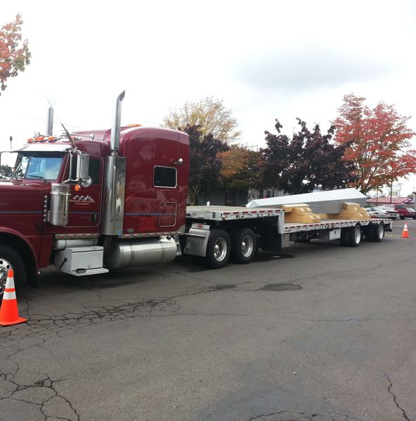 by: PHOTO COURTESY: RACHAEL MORTENSEN - A flat-bed truck moves a 33-foot granite obelisk, to be erected in June to honor World War II veterans at the state Capitol in Salem, on its way to Camp Withycombe for a Nov. 7 event.