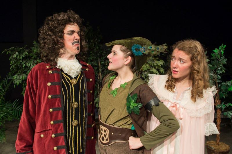 by: SUBMITTED PHOTO - The Peter Pan cast of 85 students from elementary through high school includes, from left, Jake Thiessen as the villain Captain Hook, Megan Bradner as Peter Pan and Emily Derby as Wendy.