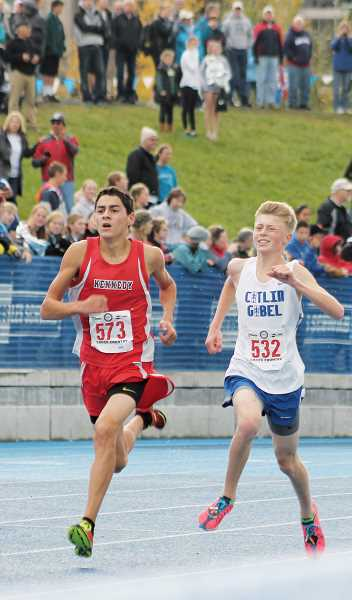 by: CORY MIMMS - Kennedy senior Dalton Susee, left, stays just ahead of Catlin Gabels Max Fogelstrom to finish 16th at the 3A/2A/1A cross country state championships in Eugene last Saturday.