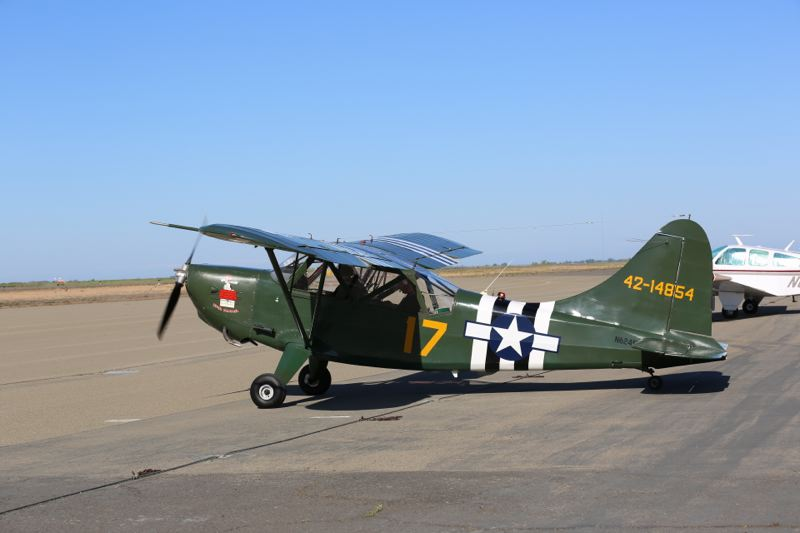 by: PHOTO COURTESY: RACHAEL MORTENSEN - Pictured is a 1942 L-5 Stinson airplane. Camp Withycombe's Veterans Day event will include a flyover of warplanes.
