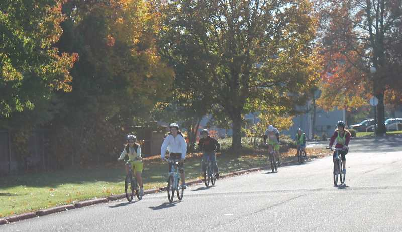 by:  KATE HOOTS - Eighth-graders at Inza R. Wood Middle School return from a bike ride at the end of their wellness class period Oct. 29.