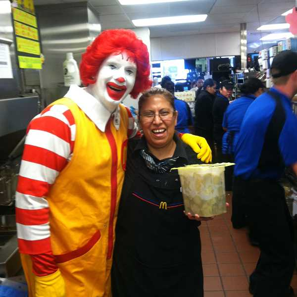 by: SUBMITTED - Ronald McDonald visited the Woodburn restaurant on Mount Hood Avenue last week. The restaurant marked its 1-year anniversary celebration. with 99-cent Big Macs, selling more than 4,400 throughout the day.
