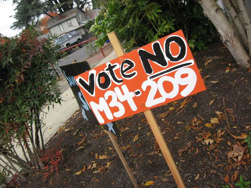RAY PITZ - Here's one of the homemade signs calling for voters not to pass the annexation measure.