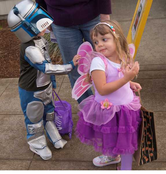 by: RAY HUGHEY - Lila Van Gorder, 3, right, shows off her fairy princess wings to friend Leo McGee, 4