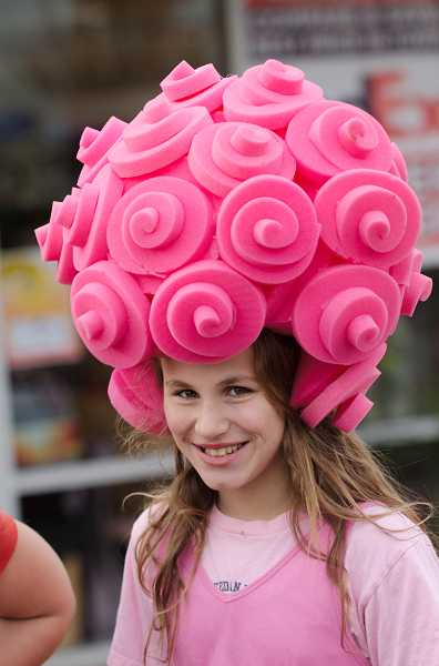 by: RAY HUGHEY - Amber Winter, 10, sported a bubble gum 'do' for Halloween.
