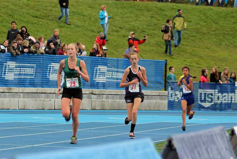 by: CORY MIMMS - Cheyenne McCoy, right, closing in on the finish at the State Championships on Saturday, Nov. 2, in Eugene.