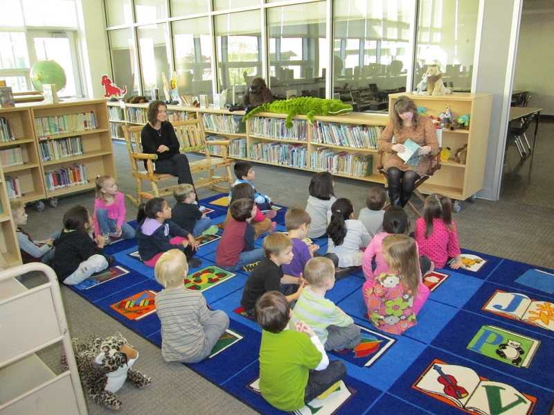 by: COURTESY PHOTO - Library clerk Jesse Castellanos reads to kindergarteners at Joseph Gale Elementary School. She said shes always wanted to be a librarian and has two years of experience as a library assistant at the Aloha Community Library.