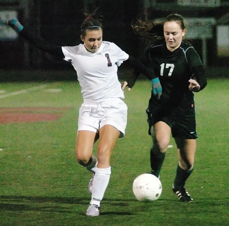 by: PAMPLIN MEDIA GROUP: DAN BROOD - Madison Horn (left), Wilson junior, competes with Sherwood's Taylor Cole for possession during the Tuesday night state playoff game, which the Trojans won in a major upset, 2-1 in overtime.
