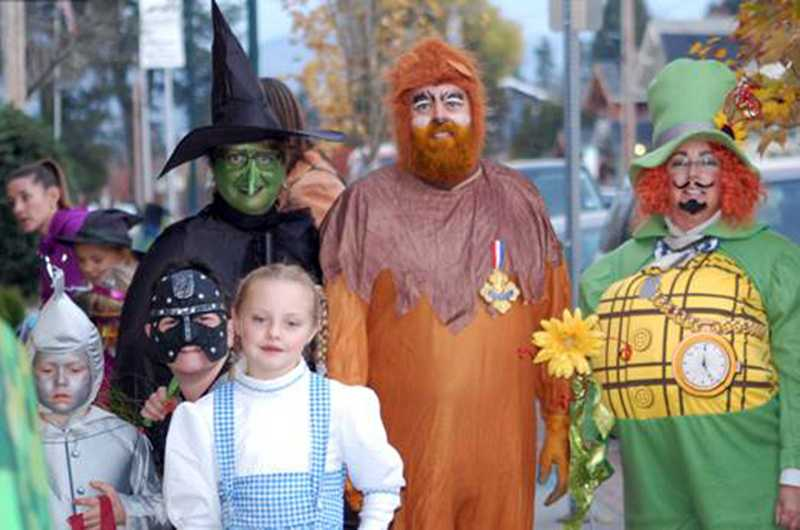 by: NEWS-TIMES PHOTO: PATRICIA GARNER - A Wizard of Oz clan hit the Forest Grove streets on Halloween.