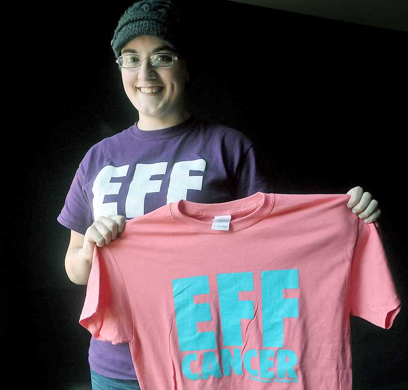 by: GARY ALLEN - Many joining the effort - Hayley Bellows displays some of the t-shirts and sweatshirts created to support her fight against two types of cancer.