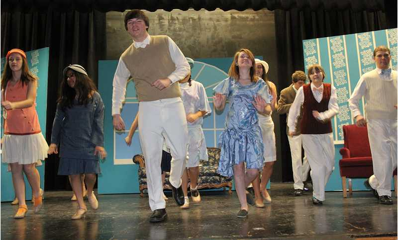 by: LINDSAY KEEFER - Josh Benson, who plays Bobby Van Husen, and Bekah Dron, who plays Maisie, lead the cast of 'The Boy Friend' in dancing the Charleston during a recent rehearsal. The show will be performed at North Marion High School Nov. 8 and 9 at 7:30 p.m. Tickets are $6 for adults and $4 for students and seniors.