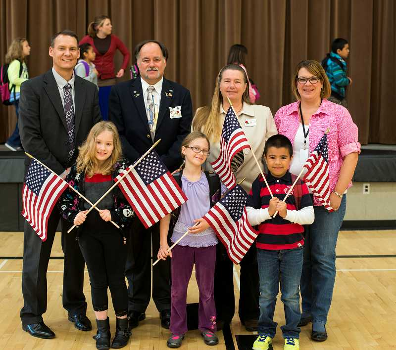 by: NEWS-TIMES PHOTO: CHASE ALLGOOD - The Elks were honored at an assembly at Free Orchards Elementary School in Cornelius last month.