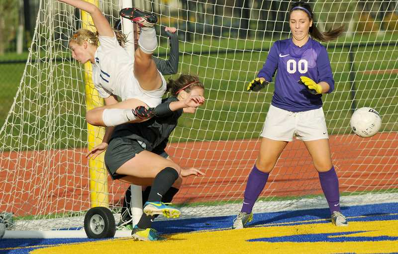 by: SETH GORDON - Megan Myers is upended charging the goal in the Tigers' 5-1 loss to North Santiam Oct. 29.