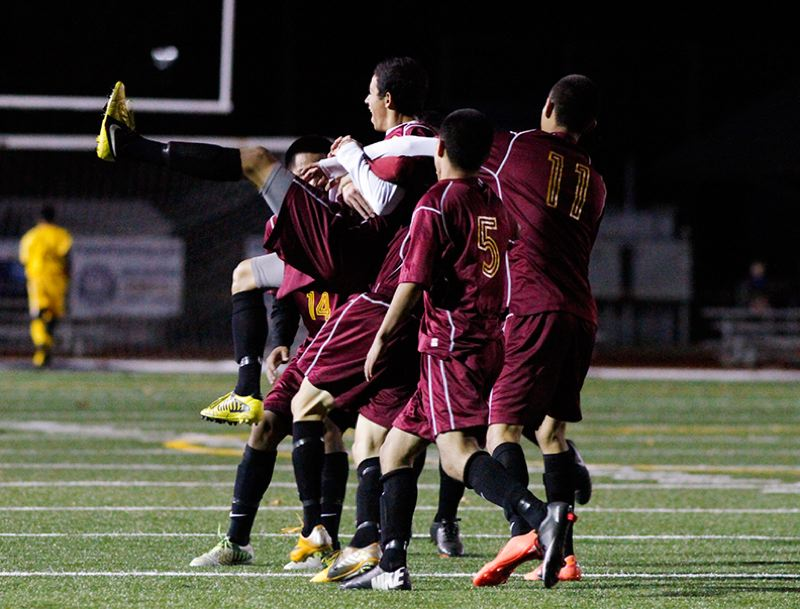 by: NEWS-TIMES  PHOTO: AMANDA MILES - Forest Grove players hoist teammate Hector Ortiz after the junior scored one of his two goals in a 3-0 upset victory over Lake Oswego.