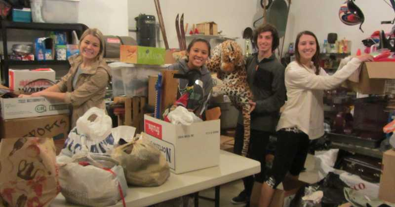 by: SUBMITTED PHOTO - West Linn High School students are working hard to sort and price items that will be available to buy at the rummage sale on Nov. 16. From left are Hailey Westover, Jazmine Agcaoili, Colby Gray and Leah Beyer.