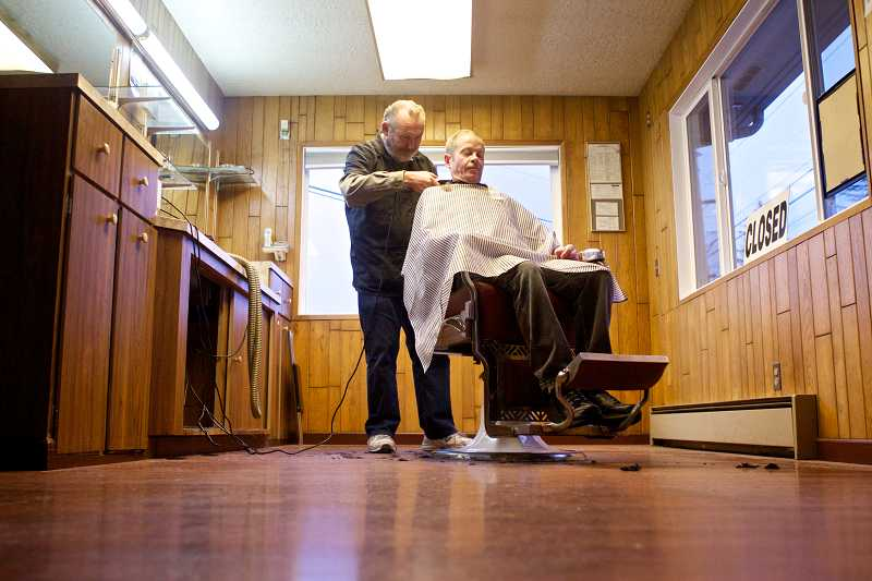 by: TIMES PHOTO: JAIME VALDEZ - Vern Stevens, of Metzger, trims Scott Brisbane's hair. Stevens isn't sure what's in store for him after he retires from his 46-year career at the Y Barber Shop in Beaverton.