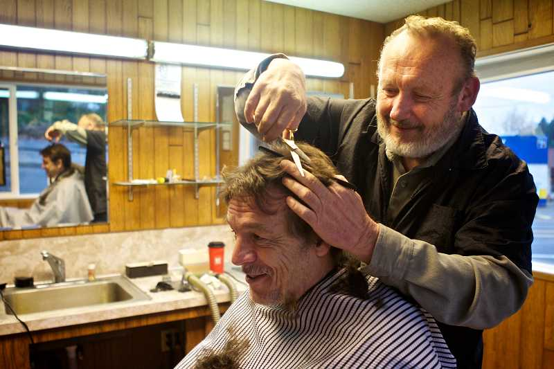 by: TIMES PHOTO: JAIME VALDEZ - Paul Gorman has had his hair cut by Y Barber Shop owner Vern Stevens for 25 years.