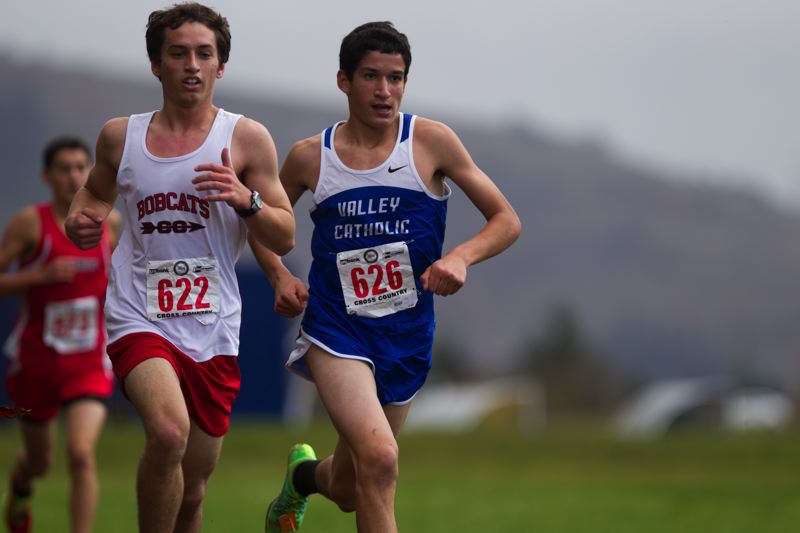 by: TIMES PHOTO: DAVID BLAIR  - Valley Catholic sophomore Ben Davidson races to the finish line for the Valiants at the 3A cross country state championships on Saturday.