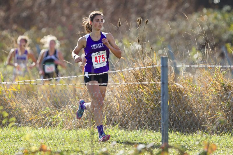 by: TIMES PHOTO: DAVID BLAIR - Sunset senior Charlotte Corless took third at the 6A State Championships on Saturday and helped the Apollo girls place first overall.