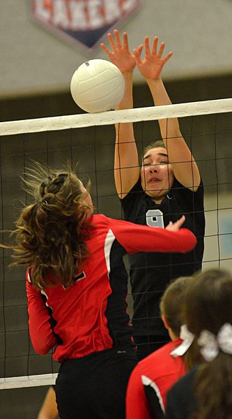 by: VERN UYETAKE - Malia Scott goes up for a block during Lakeridge's opening-round playoff victory against Lincoln. The Pacers won the match in straight sets.
